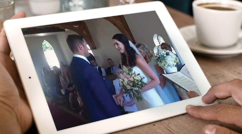 Watching a wedding from home on an iPad.
